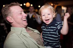Ian, held by dad, boogieing on the dance floor